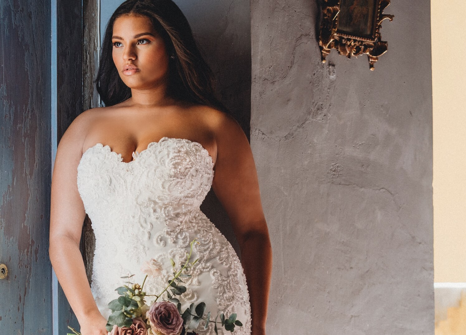 Brunette plus size bride in a white gown